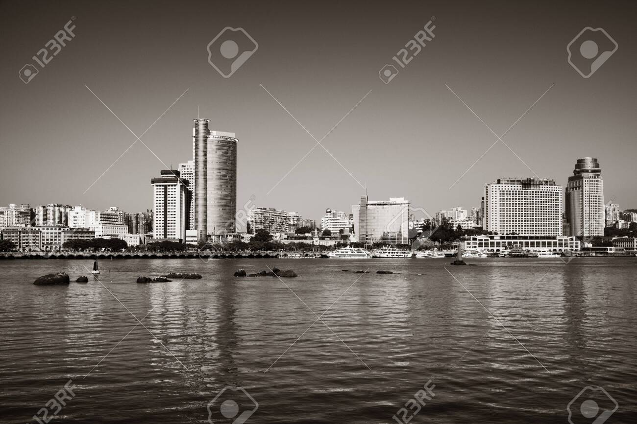 Urban buildings at waterfront in Xiamen, Fujian, China. - 129572178