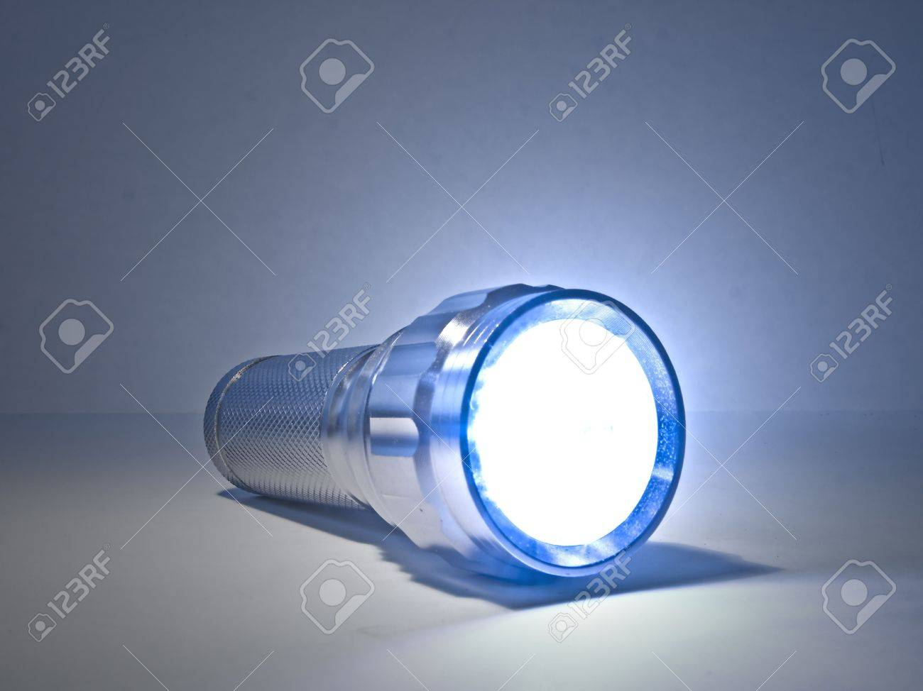 Concept image of a shining torch against a plain background Stock Photo - 2470492