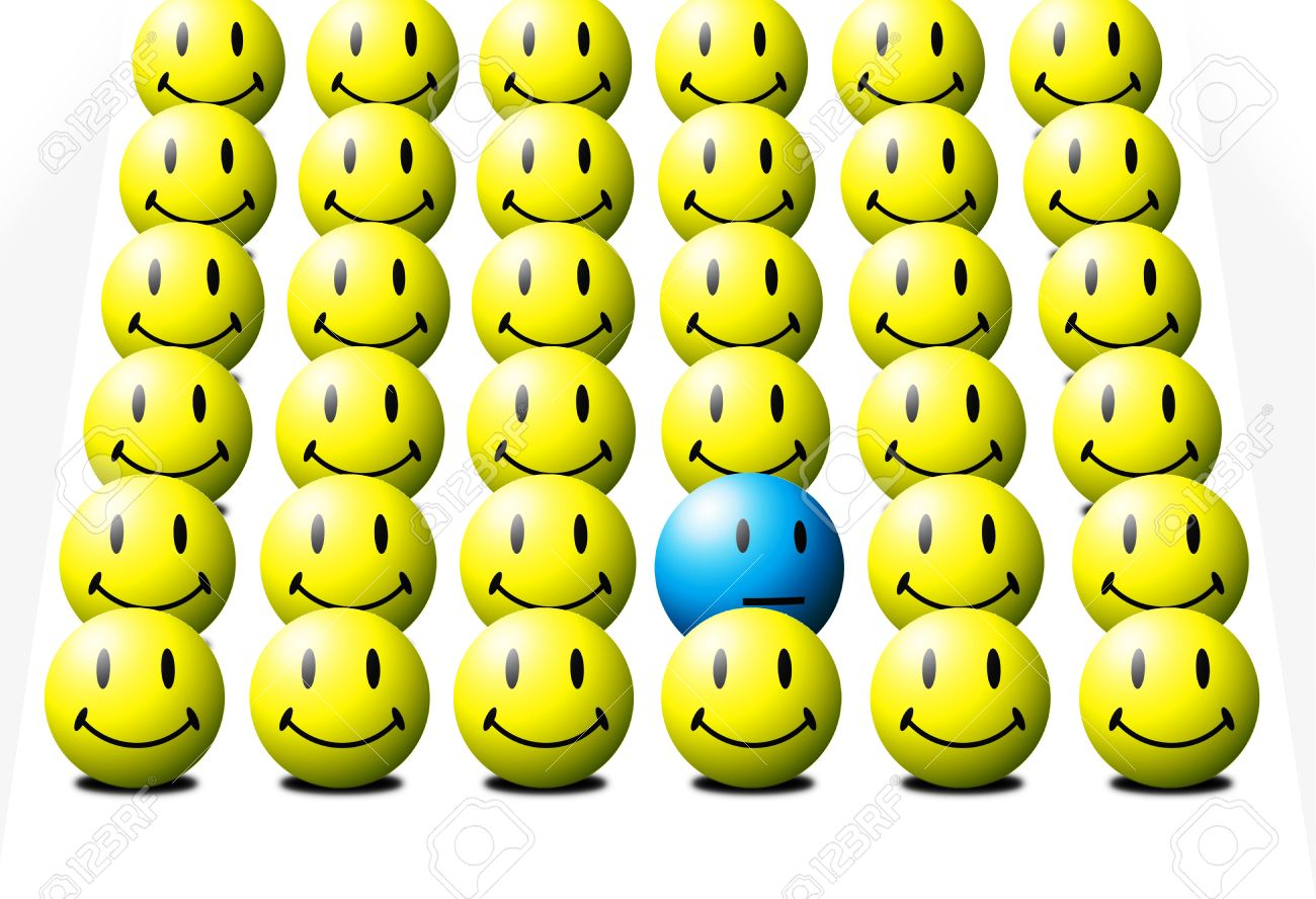One blue face among several yellow faces signifying the odd-one-out Stock Photo - 2689356