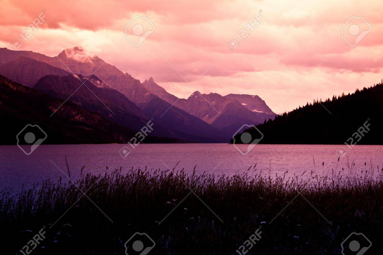 Mountain sunset on the lake Stock Photo - 15114745