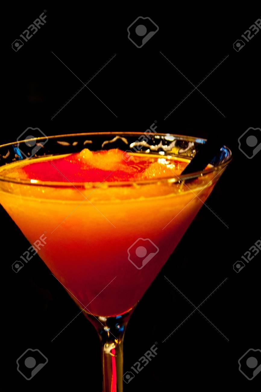 an orange Bellini alcoholic drink on a black background Stock Photo - 15703661