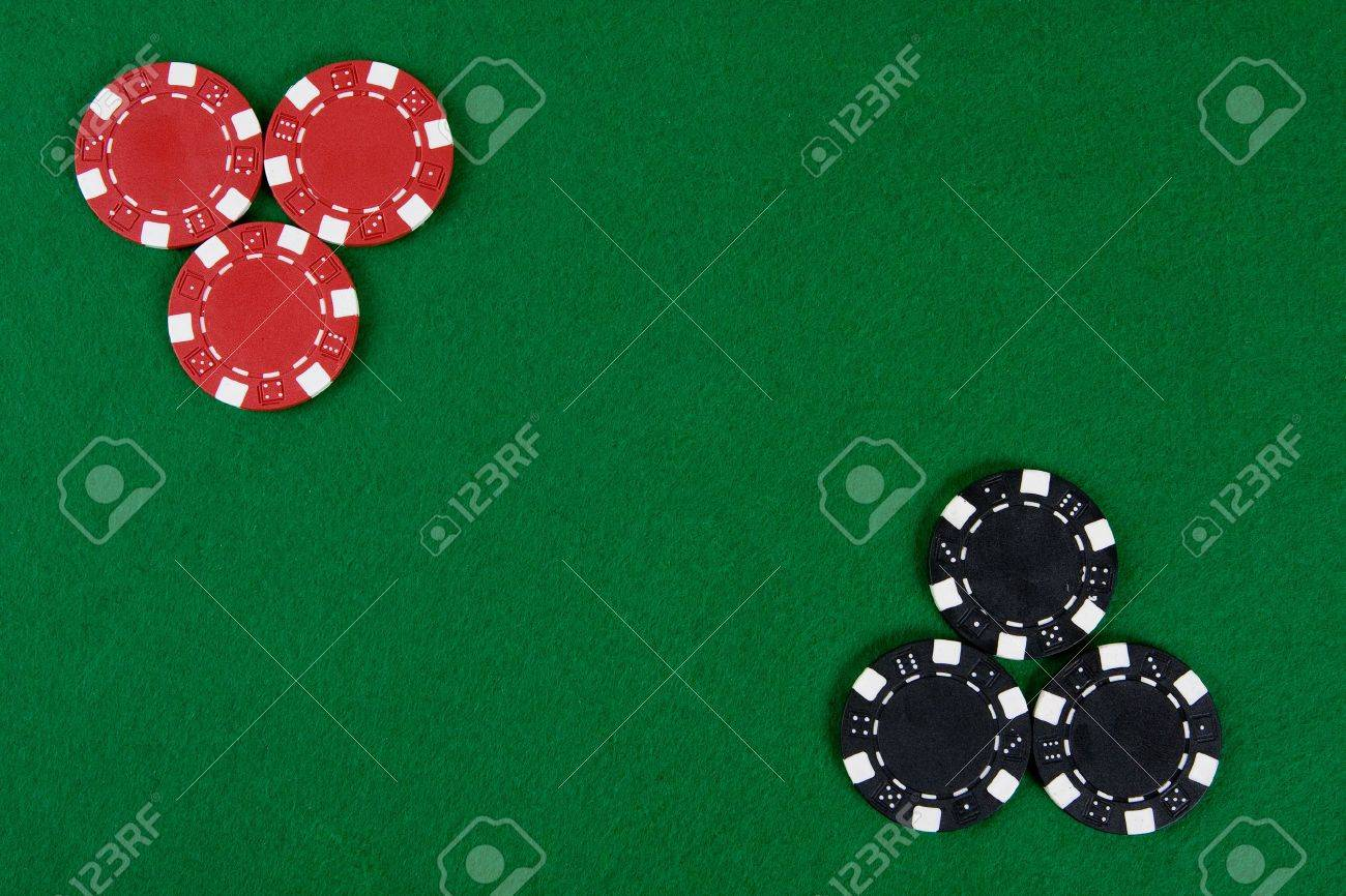 Blackjack table top view - Stock Photo Two Kinds Of Poker Chips In Two Corners Of A Green Poker Table Top View