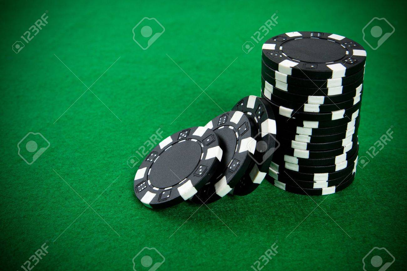 Poker table background - Stack Of Black Poker Chips On A Green Poker Table Background Stock Photo 3765802