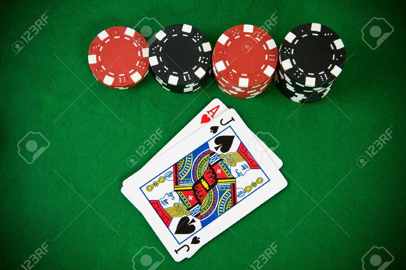 Blackjack table top view - Ace Of Hearts And Black Jack With Black And Red Poker Chips Top View