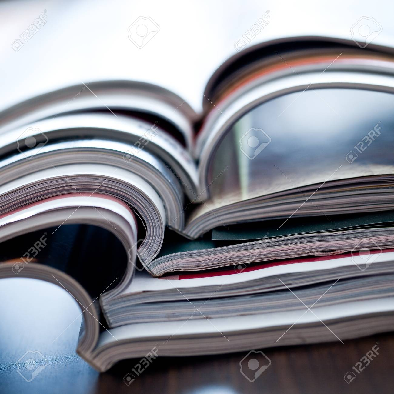 Stack of open colorful magazines - close-up Stock Photo - 6995495