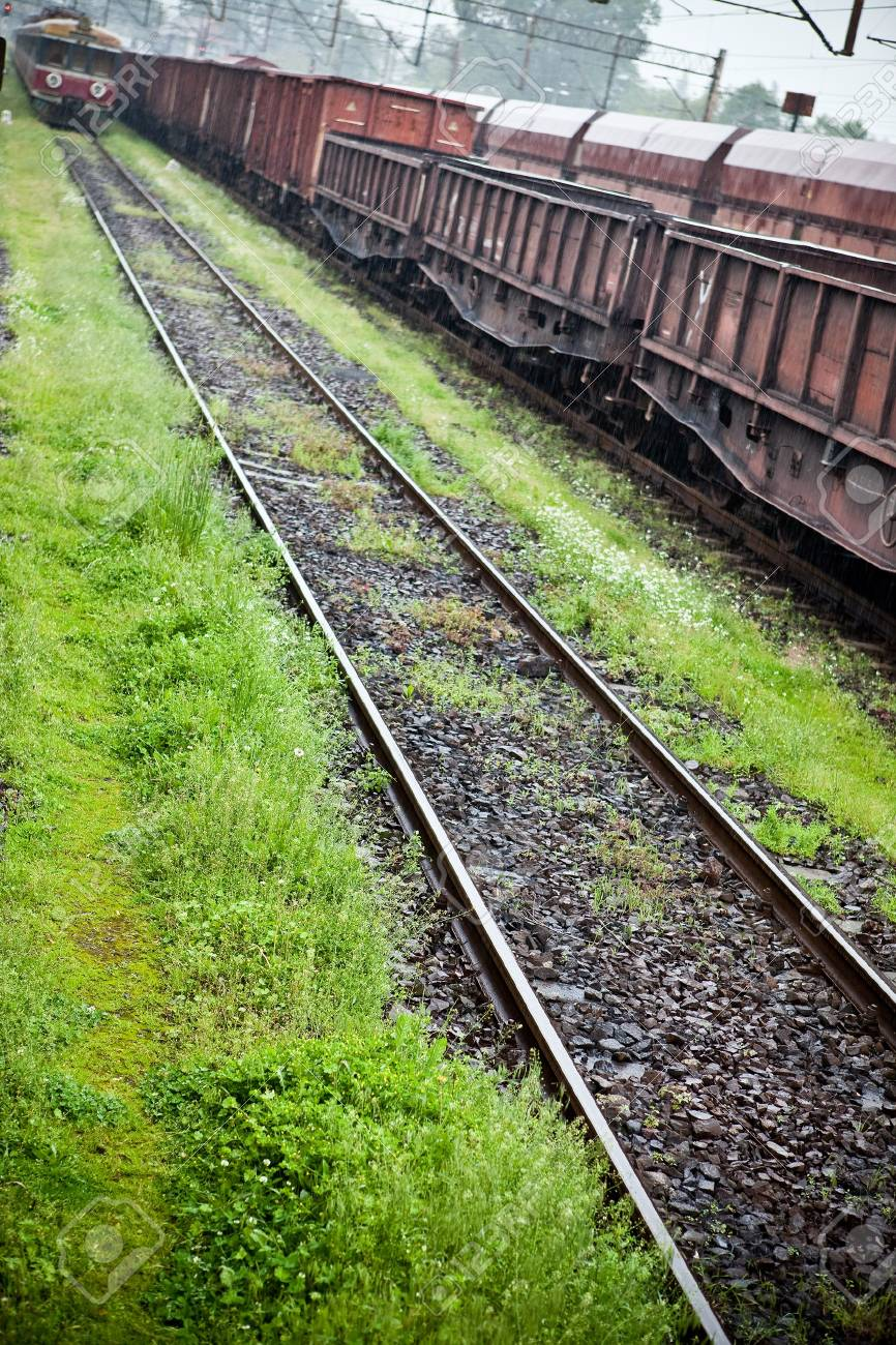 Cargo wagons in the train station during rain Stock Photo - 7823640