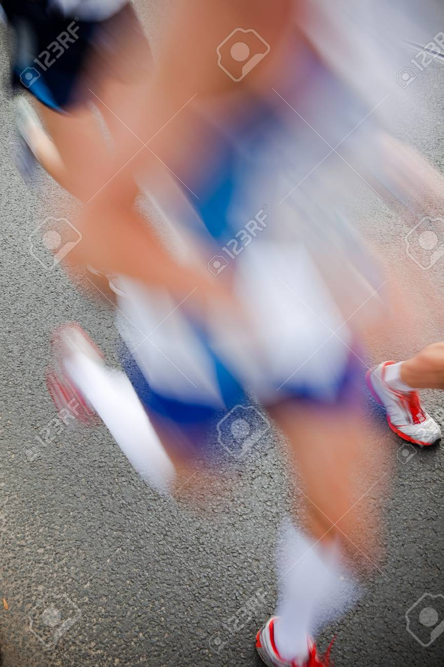 Man running in city marathon - motion blur Stock Photo - 7823600