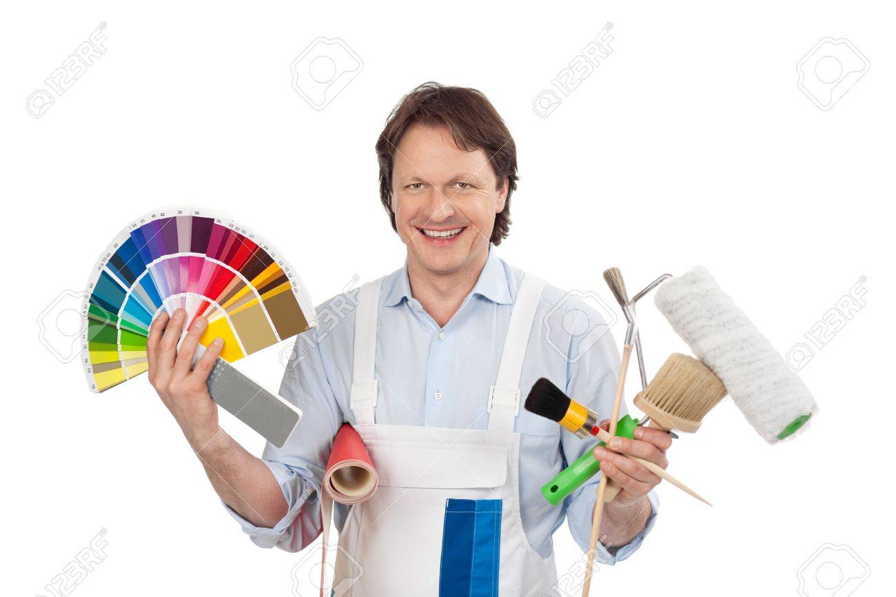 Confident Handyman With Samples Displaying Colour Charts For Stock Photo Picture And Royalty Free Image Image 20846522