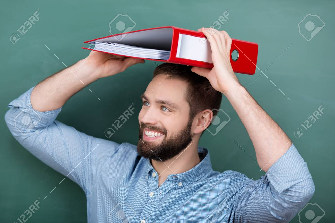 Happy young male professor placing file on head against chalkboard Stock Photo - 21109580