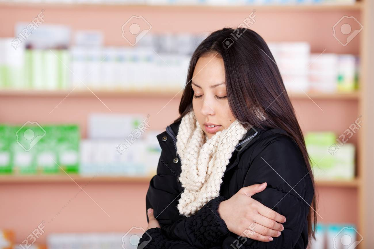 young asian woman suffering from cold standing in a drug store Stock Photo - 21146753