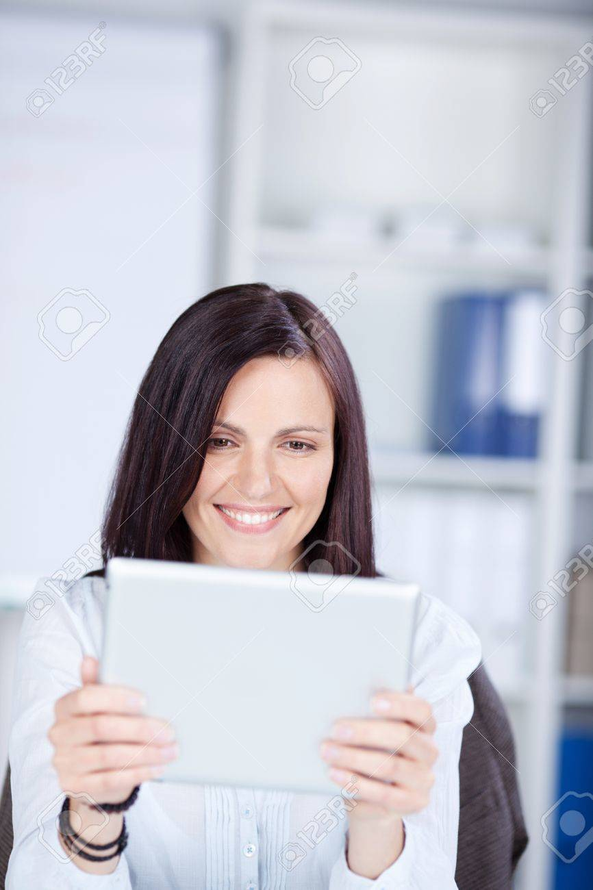 Smiling beautiful woman surfing using her ipad touch Stock Photo - 21146870