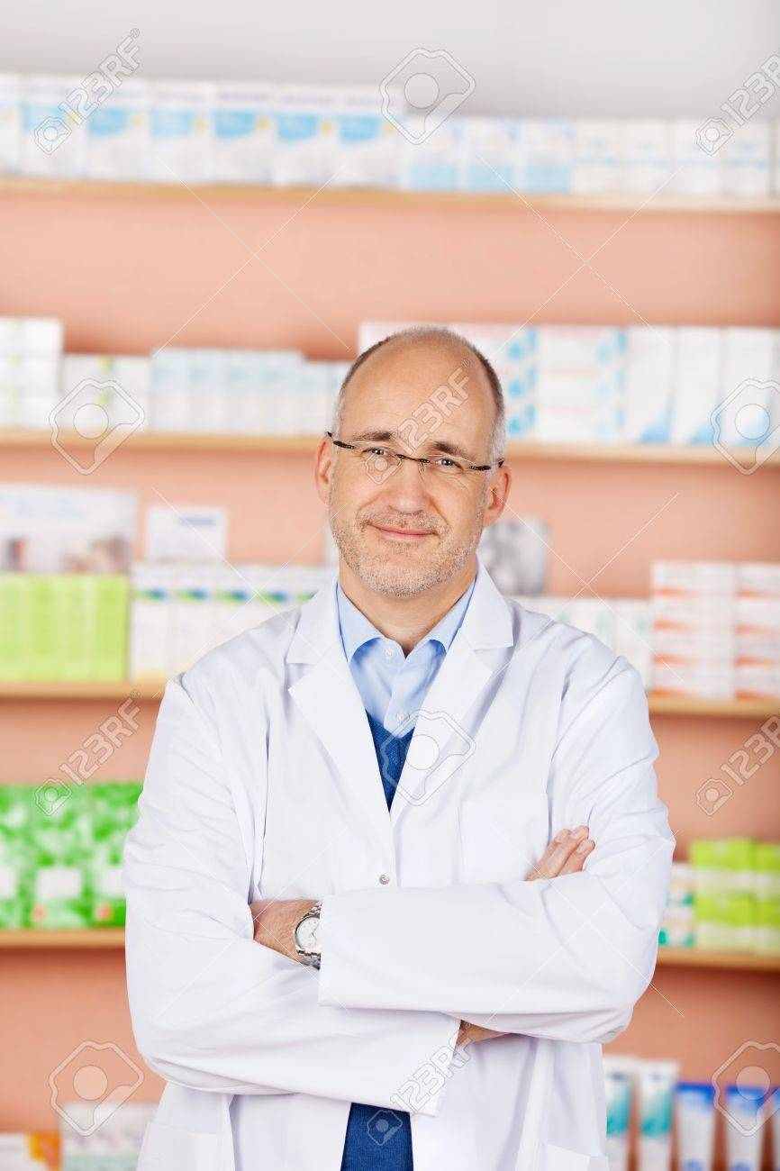 Portrait of bald friendly pharmacist in his shop Stock Photo - 21146981