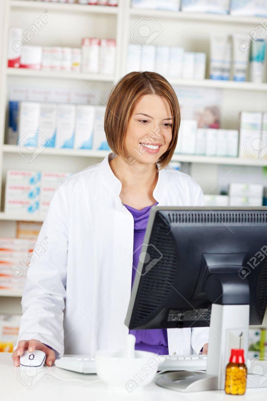 Cheerful female pharmacist chemist working inside the drugstore Stock Photo - 21148569