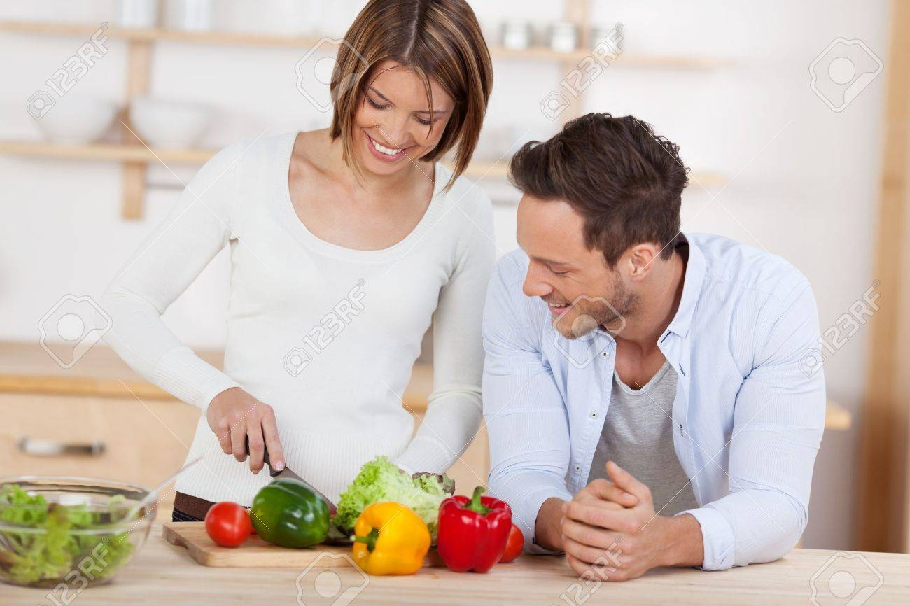 Husband and wife in their Kitchen at home preparing vegetable salad - 21162544
