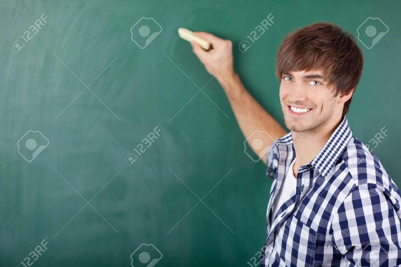 Portrait of handsome young male student writing on chalkboard Stock Photo - 21204565