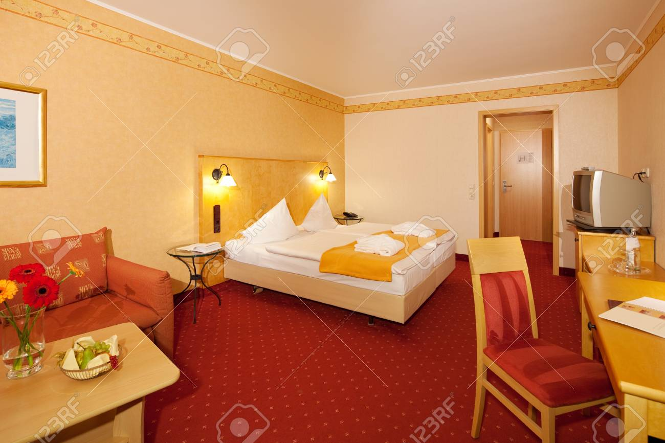 Interior of simple bedroom in hotel Stock Photo - 21219270