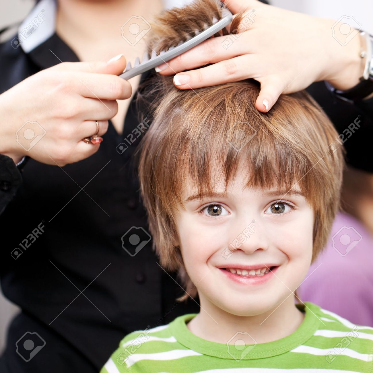Beautiful young child with large expressive eyes at the hairdresser having a haircut Stock Photo - 21235153