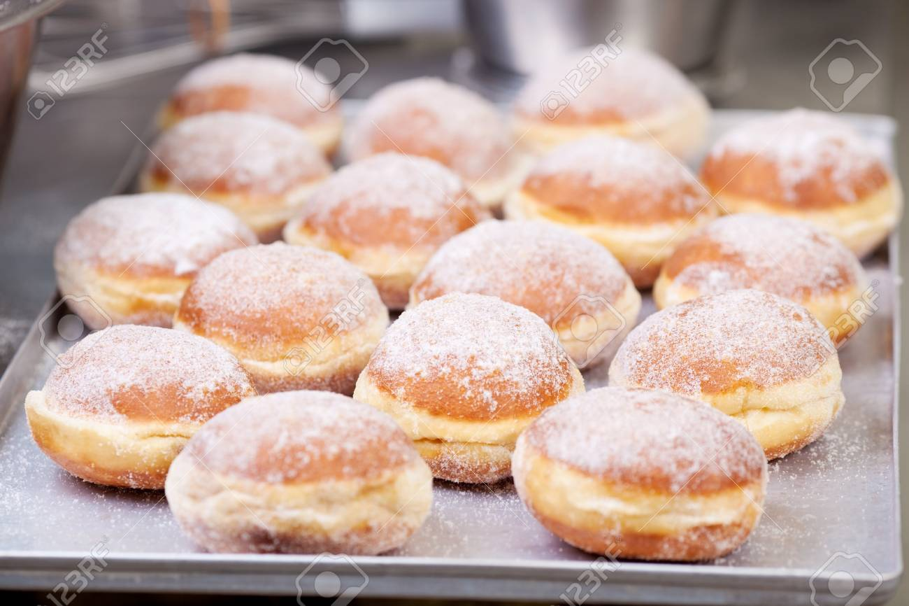 Sweet fried pastry on baking sheet in bakery Stock Photo - 21279063