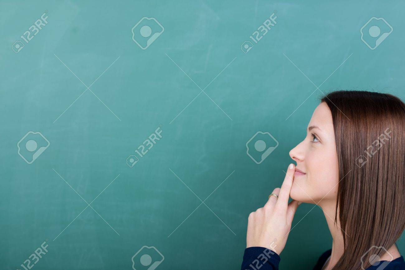 portrait of young woman with finger on lips Stock Photo - 21341198