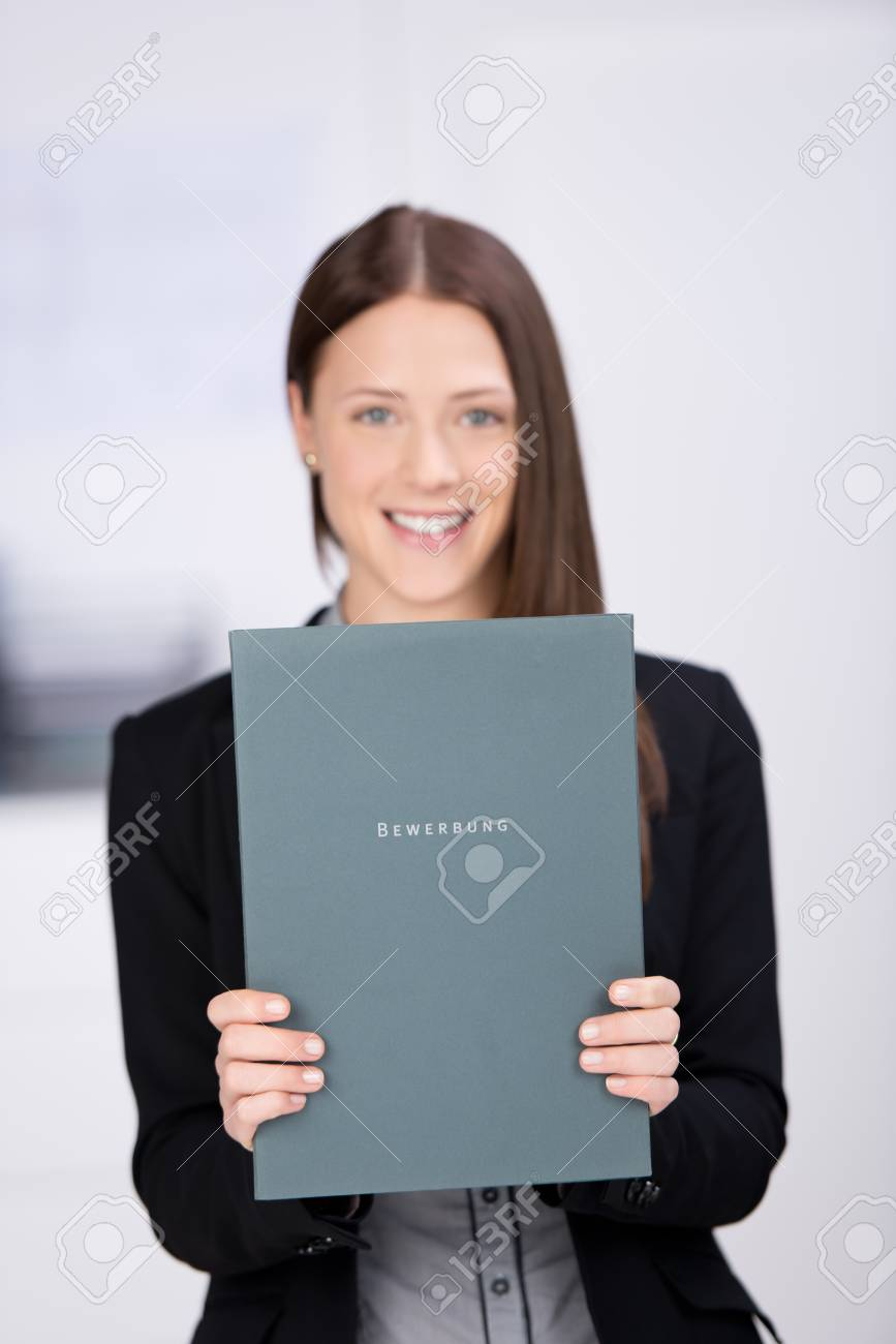 Businesswoman smiling and showing document in a close up shot Stock Photo - 21341225