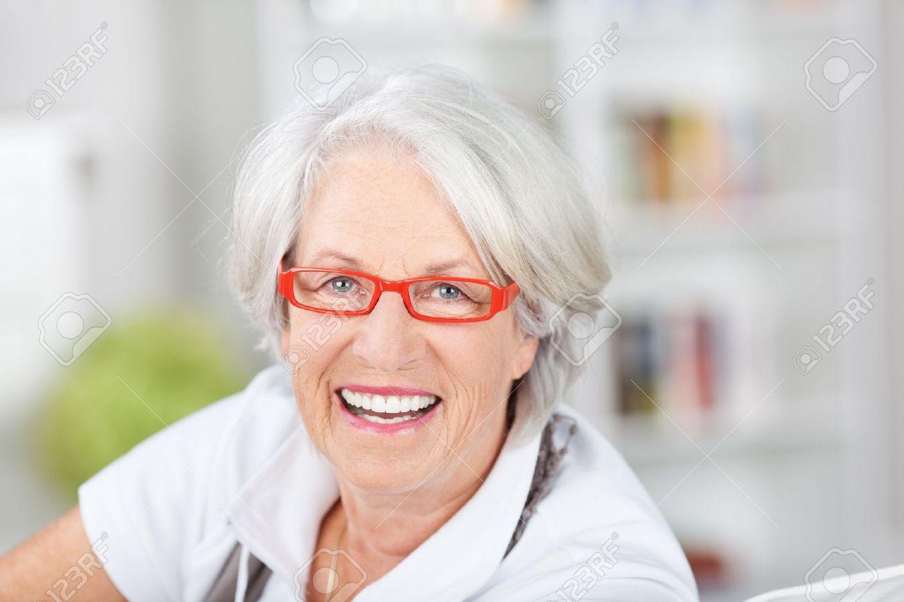 Trendy Senior Woman In Modern Glasses With Orange Red Frames.. Stock ...
