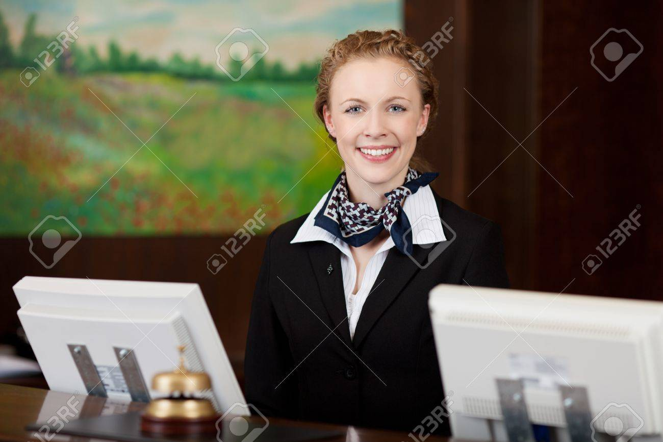 Caucasian happy woman working as a professional receptionist in a hotel Stock Photo - 21375242