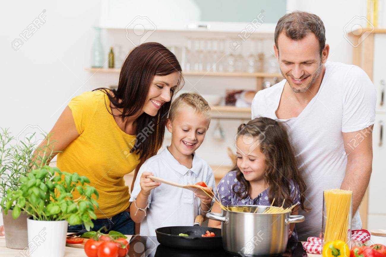 Family cooking kitchen - Family Cooking Happy Young Family With Mum Dad And Two Young Children Cooking In
