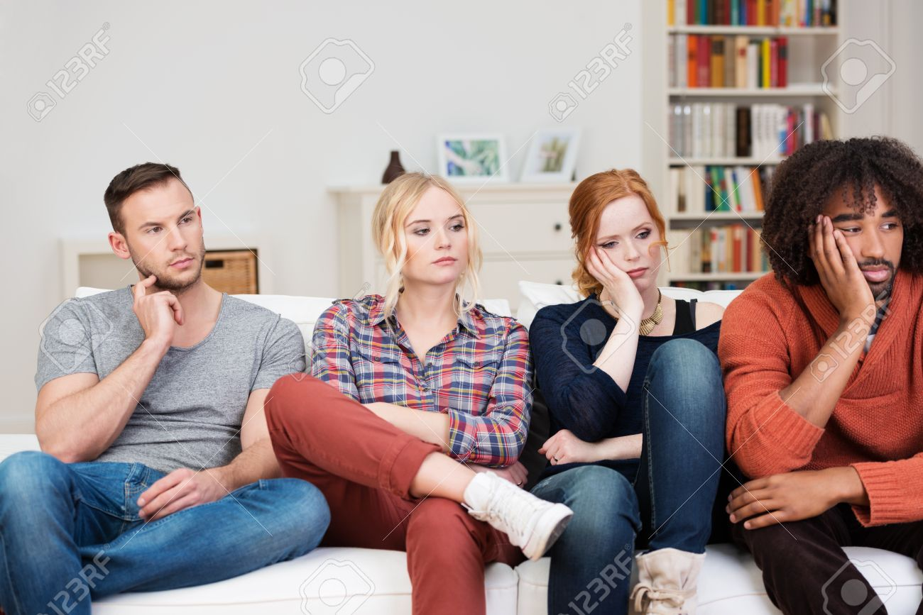 Bored Group Of Multiracial Friends Relaxing At Home Sitting In ...