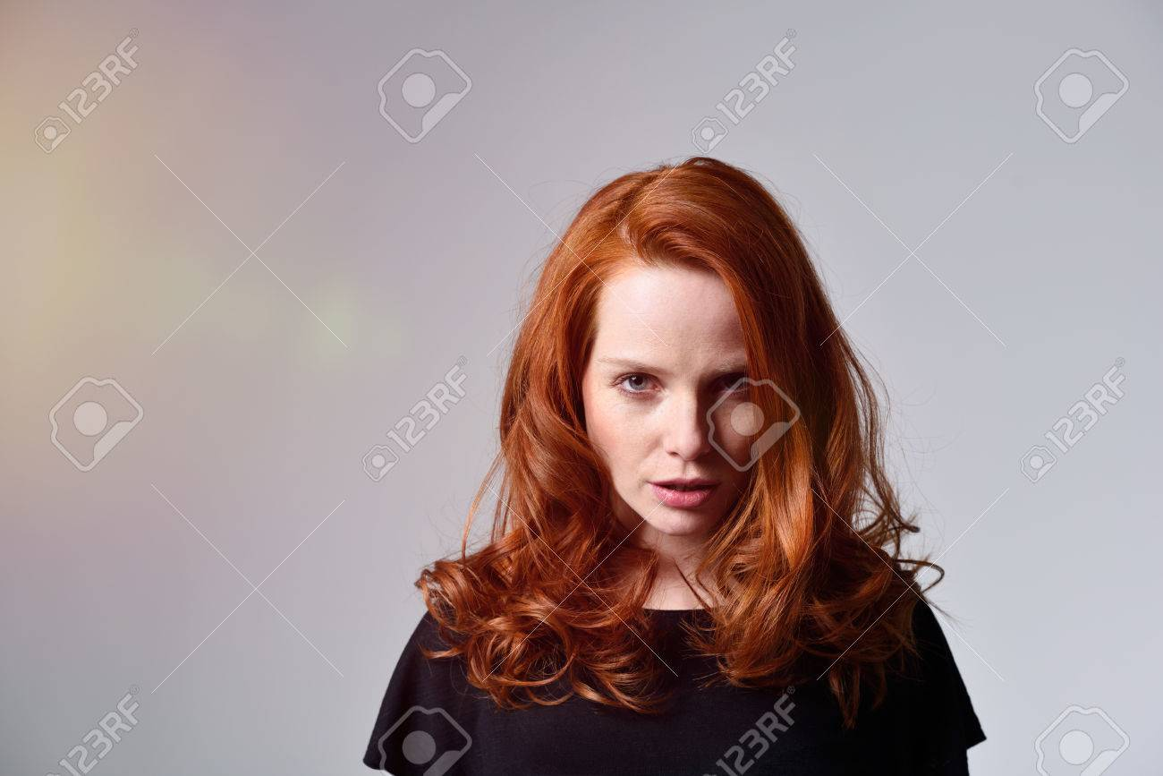 Angry Young Woman With Pretty Shoulder Length Red Hair Standing