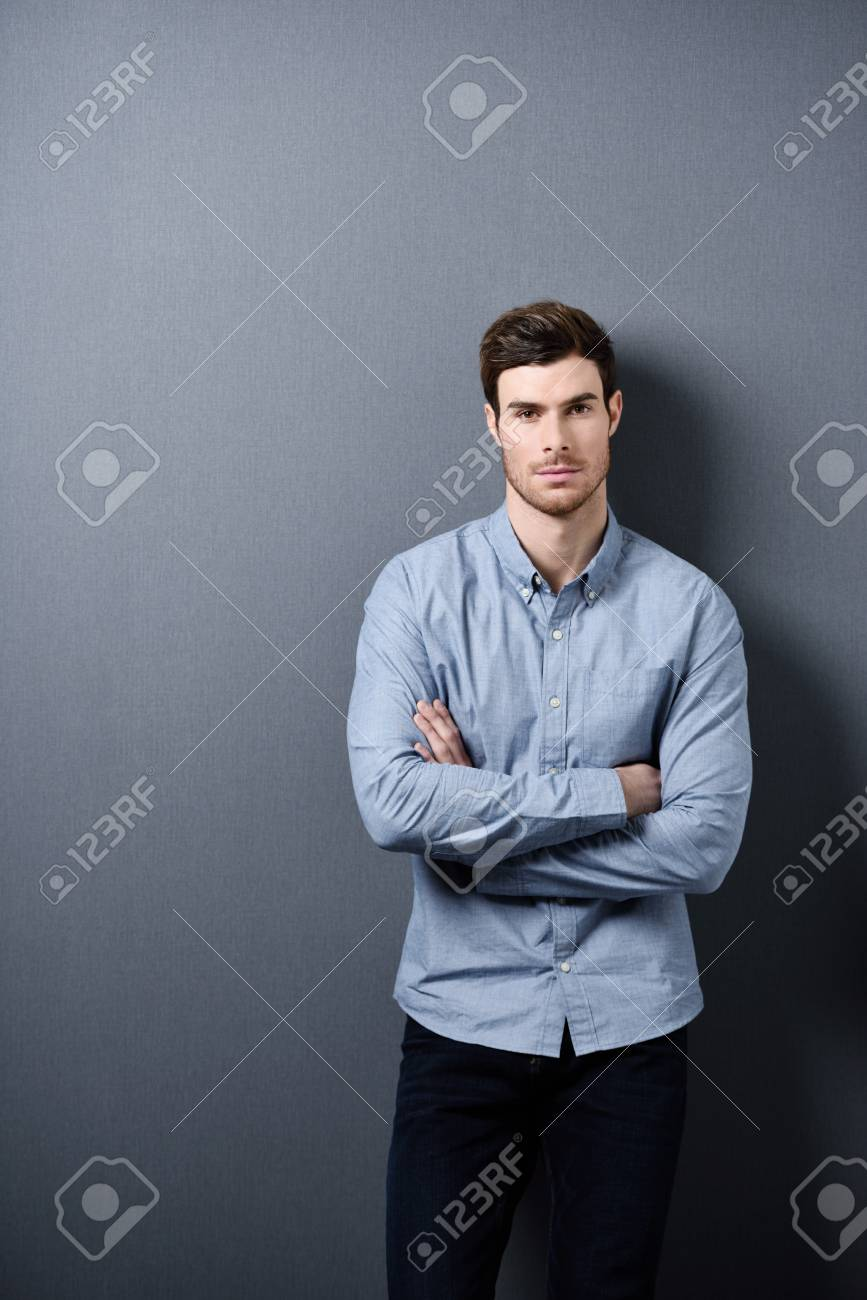 Confident Attractive Young Man with Arms Crossing Over his Chest