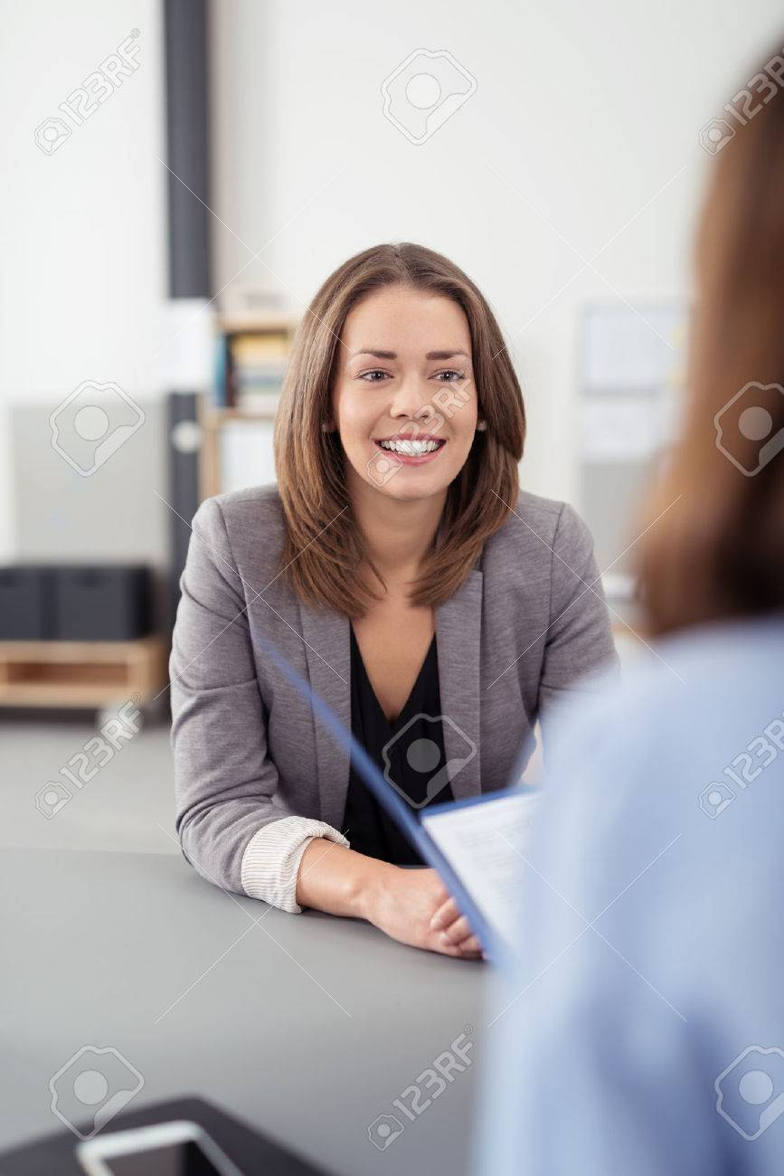 pretty young professional job seeker w being interviewed pretty young professional job seeker w being interviewed by a manager inside the office a