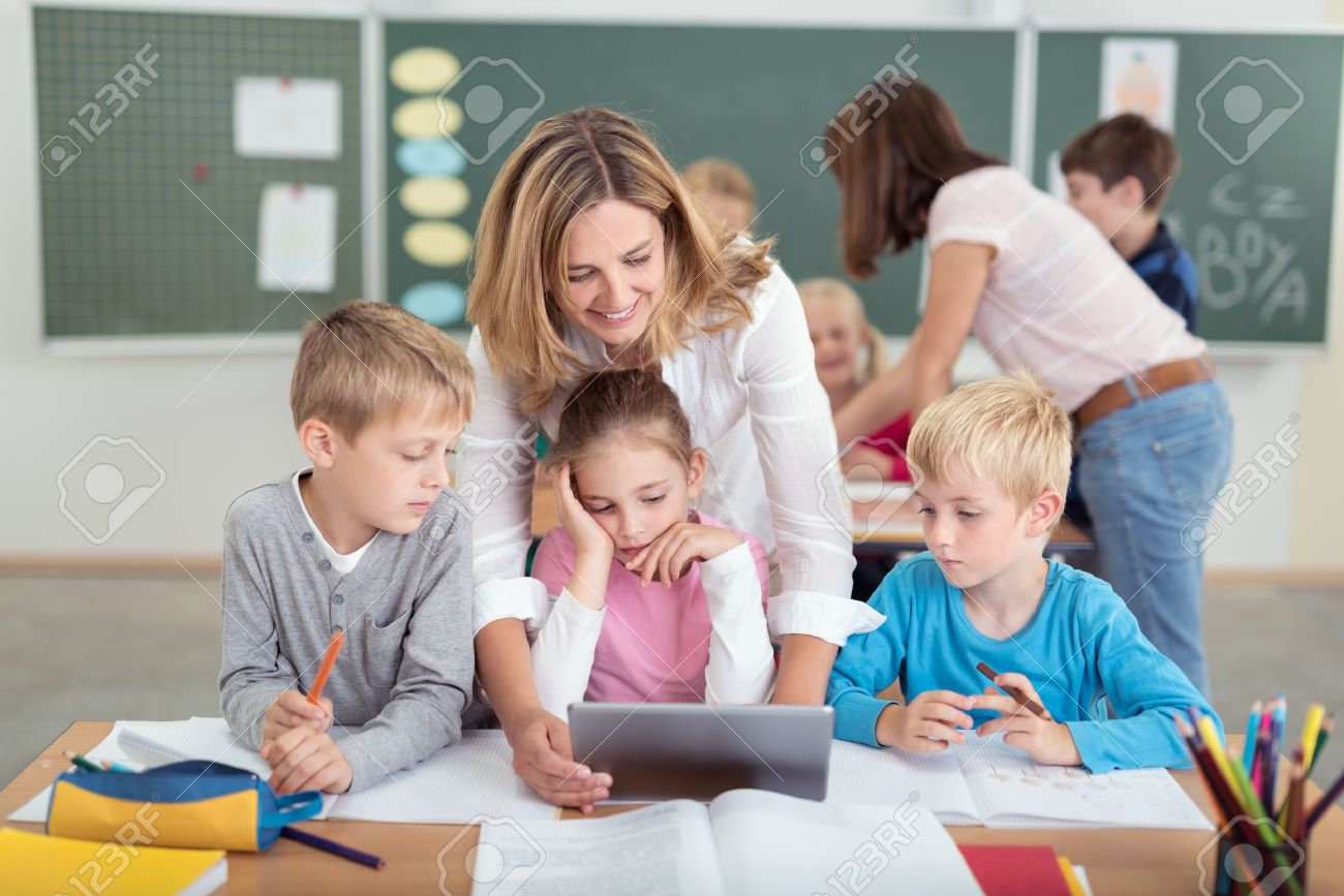 Worksheet Educational Computer Programs For Kids kids computer classes stock photos pictures royalty free cheerful female teacher with watching something educational video on tablet computer