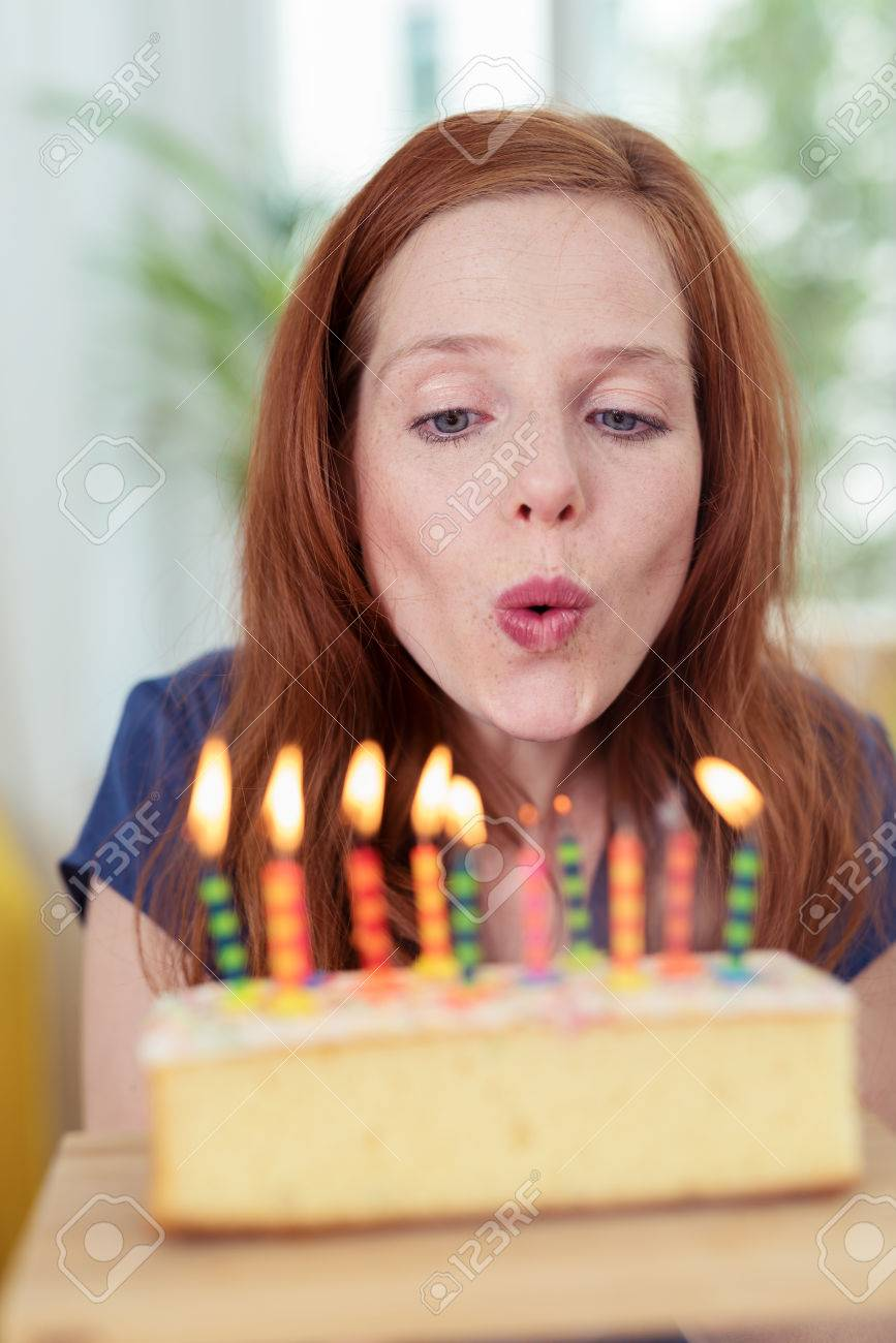 Astonishing Attractive Young Redhead Woman Blowing Out Candles On Her Birthday Funny Birthday Cards Online Unhofree Goldxyz