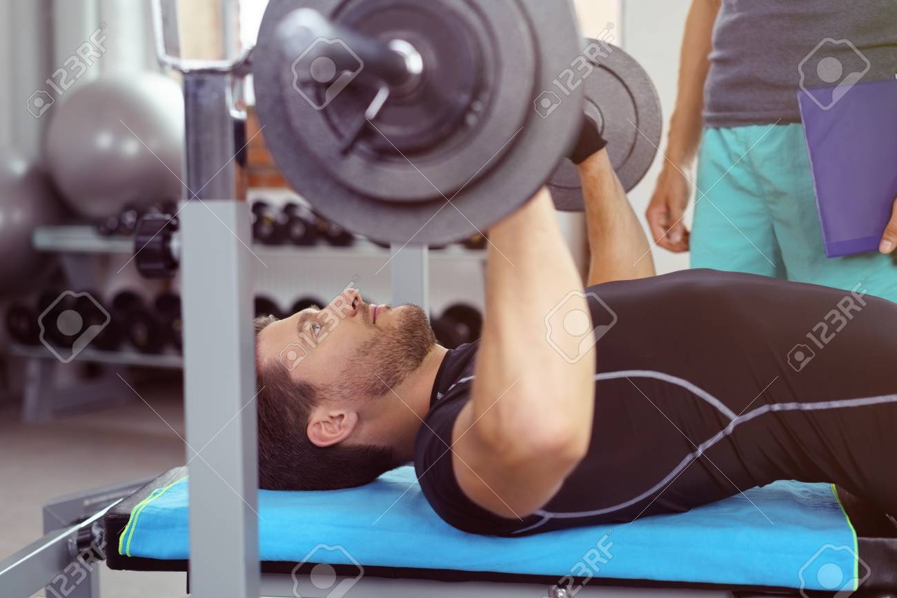 Awesome Stock Photo   Young Bearded Man Working On Bench Press Push With Barbell As  Unidentifiable Spotter Stands Nearby