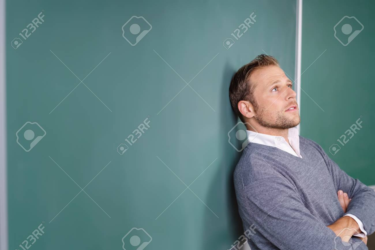 Young Male Teacher Or Post Graduate University Student Standing