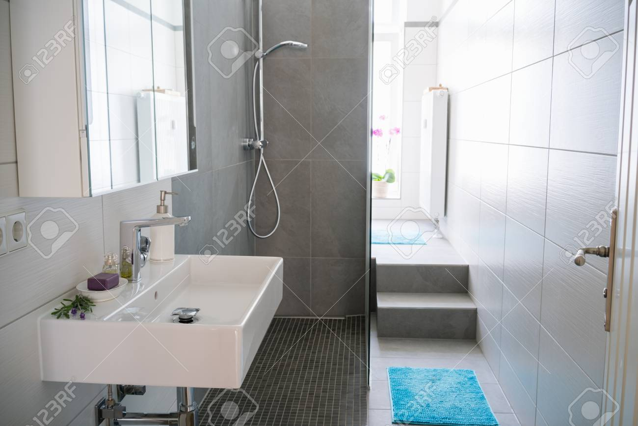 Modern Clean Bathroom Interior With Tiled Walls A Shower Cubicle ...