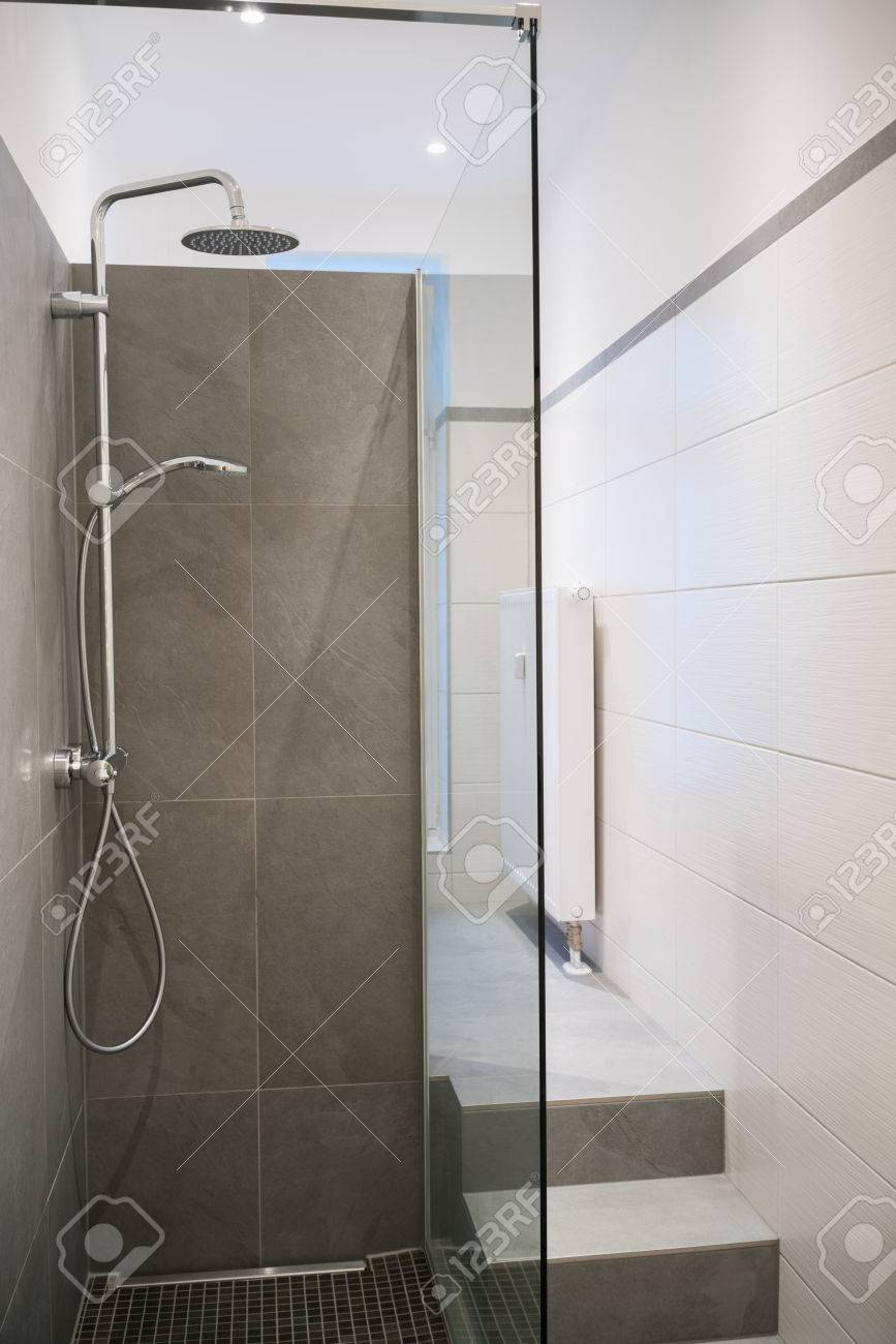 Modern Empty Glass Shower Cubicle In A Tiled Bathroom With Neutral ...
