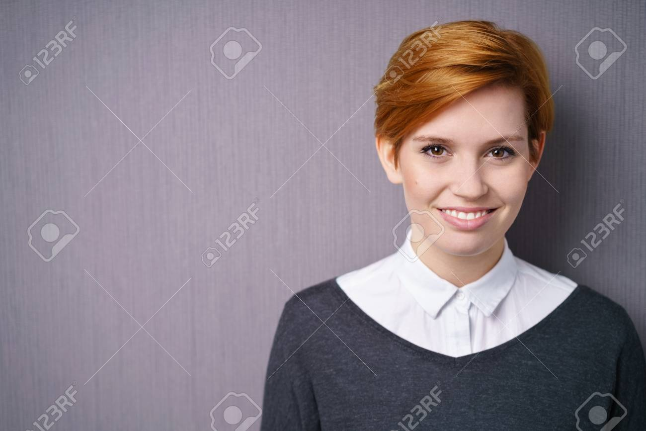 Pretty Young Woman With Short Red Hair In White Blouse And Dark