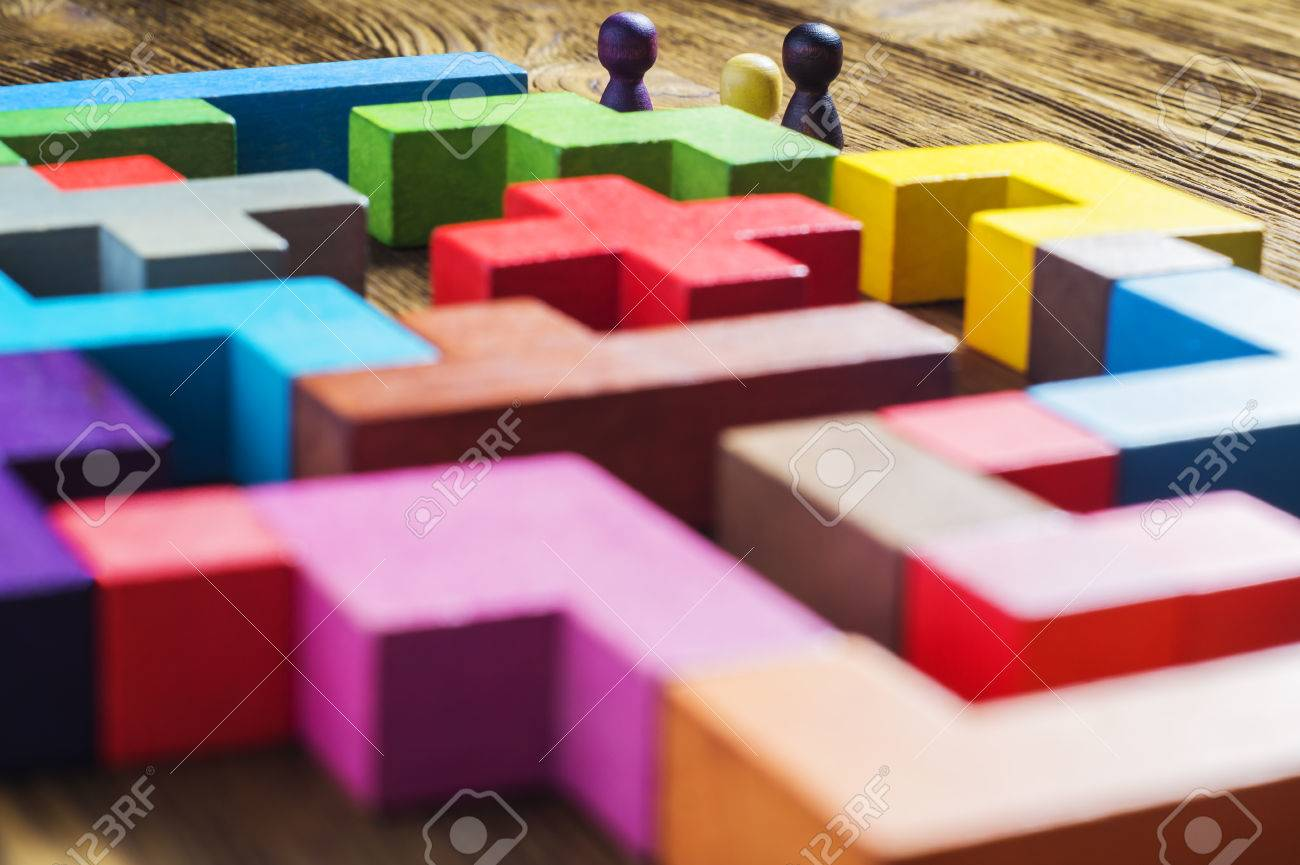 The man in the maze. The concept of a business strategy, analytics, search for solutions, the search output. Labyrinth of colorful wooden blocks, tetris. - 63375114