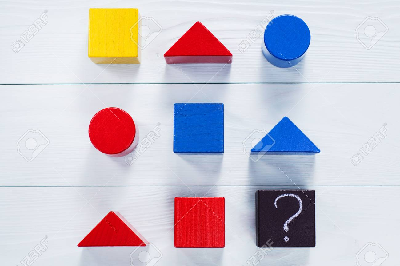 IQ test. Choose correct answer. Logical tasks composed of geometric wooden shapes. Children's educational logical task, flat lay. - 69025176