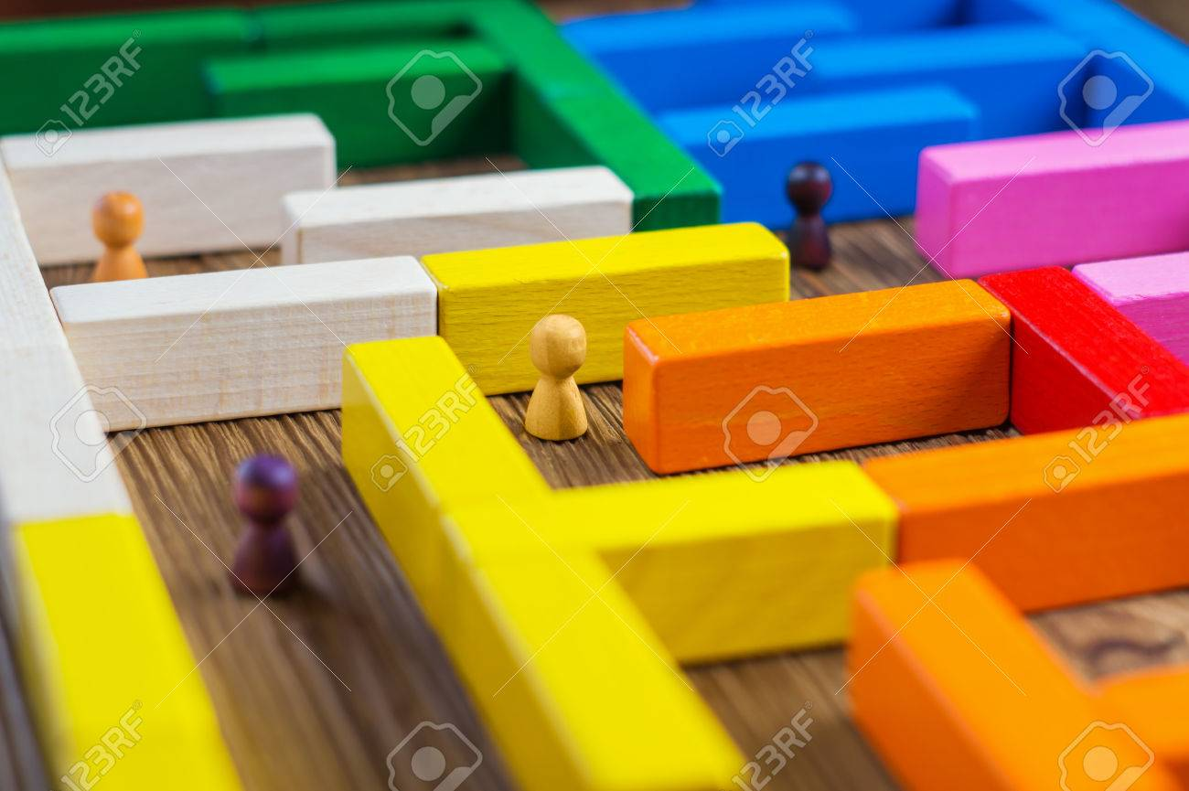People in the maze, finding a way out. The man in the maze. The concept of a business strategy, analytics, search for solutions, the search output. Labyrinth of colorful wooden blocks, tetris. - 76918608