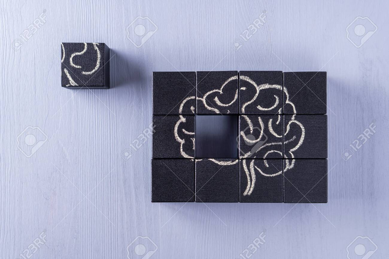 The concept of the human brain. Education, science and medical concept. Brain drawn in chalk on black cubes. - 121462258