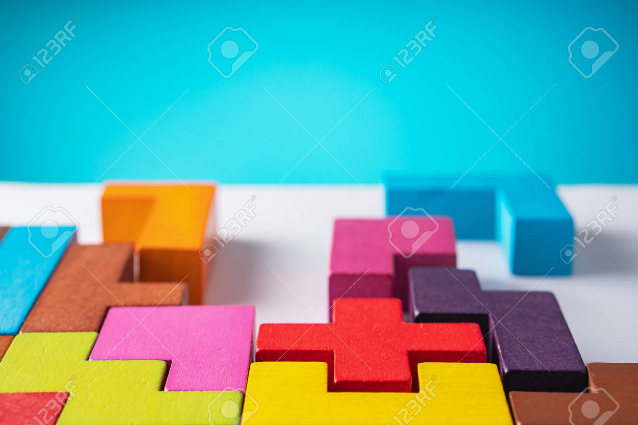 Geometric shapes on a wooden background. The concept of logical thinking. - 166513590
