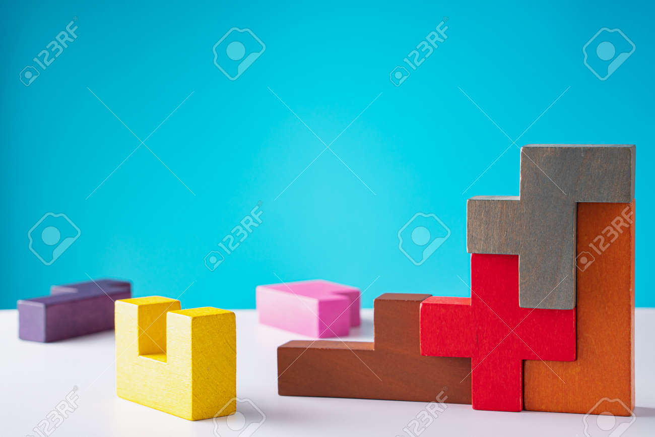 Geometric shapes on a wooden background. The concept of logical thinking. - 166145291