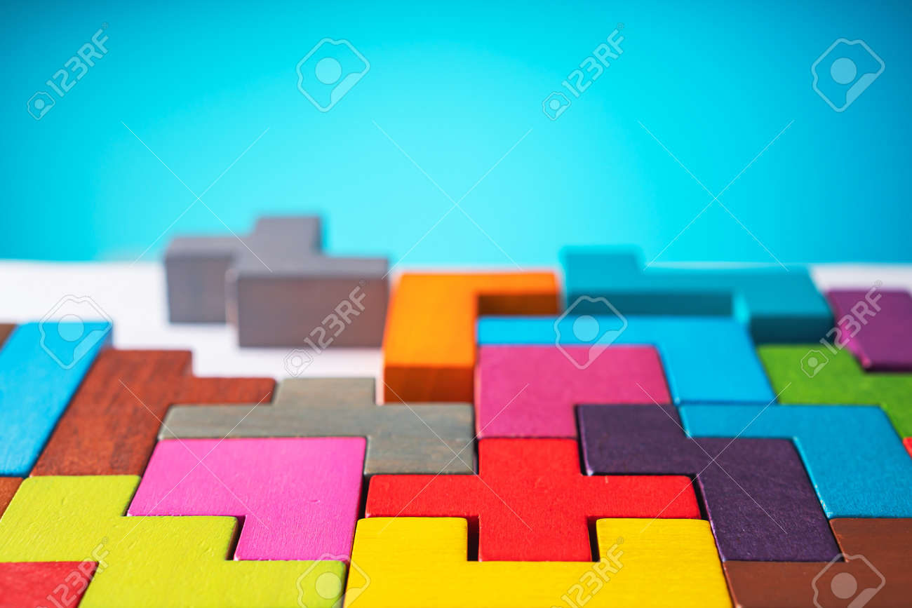 Colorful geometric shapes on a blue background. - 166145545
