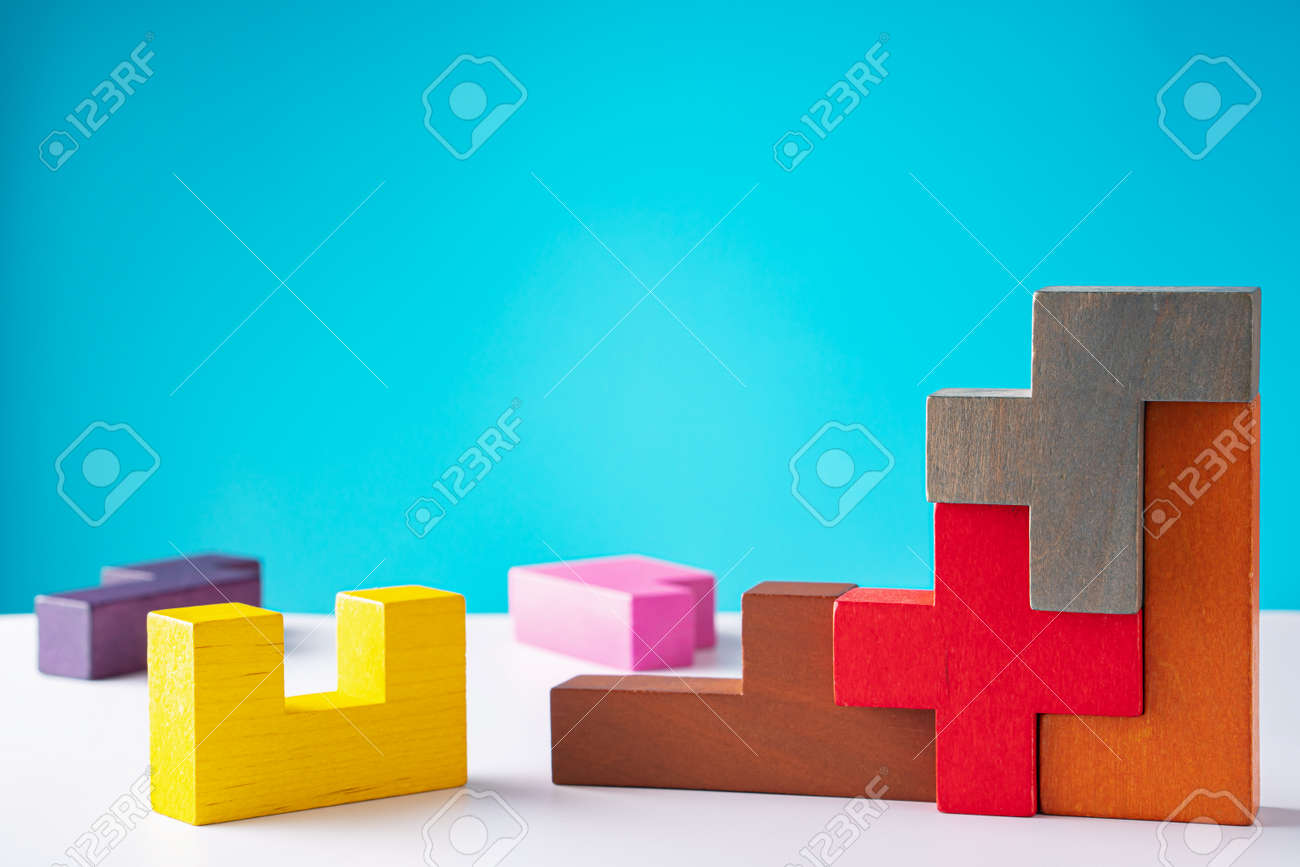 Geometric shapes on a wooden background. The concept of logical thinking. - 166145417