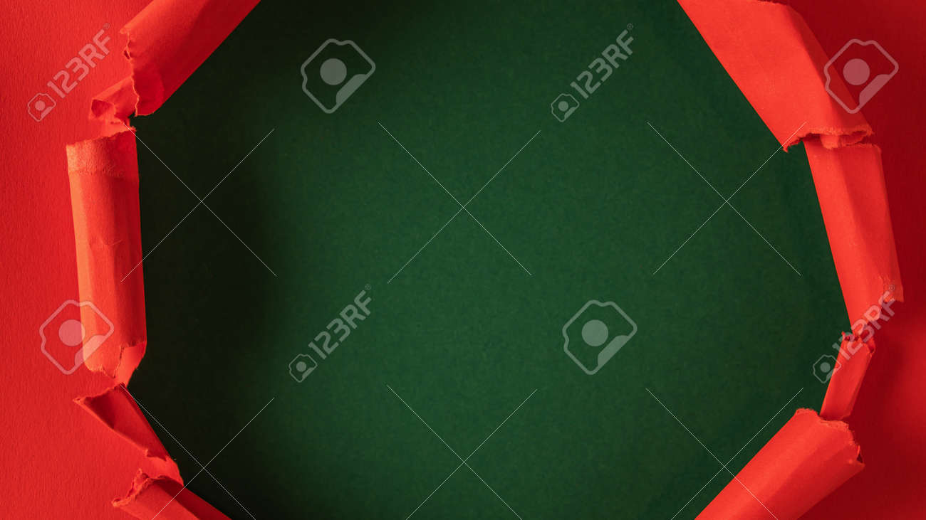 Red paper is torn over green background for message. Template for your text. - 166145457