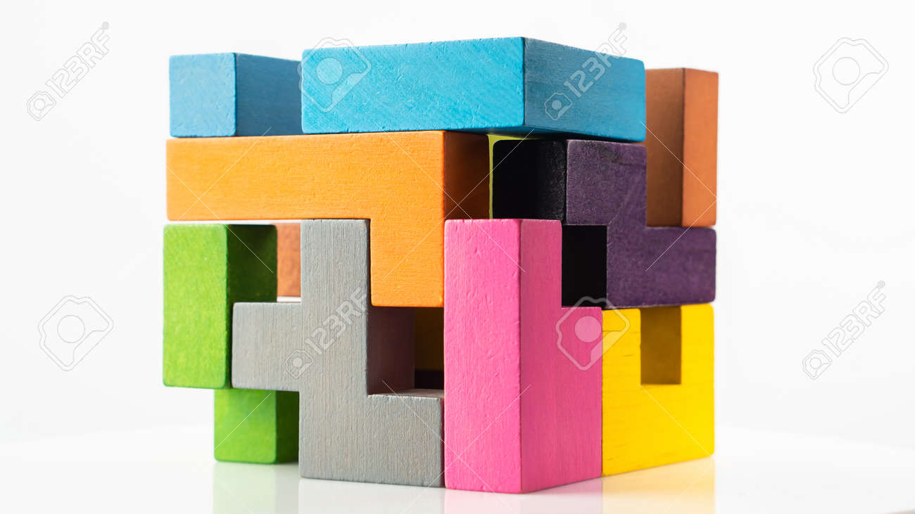 Cube made of multicolored wooden figures on a white background. Concept of logical thinking. - 166283937
