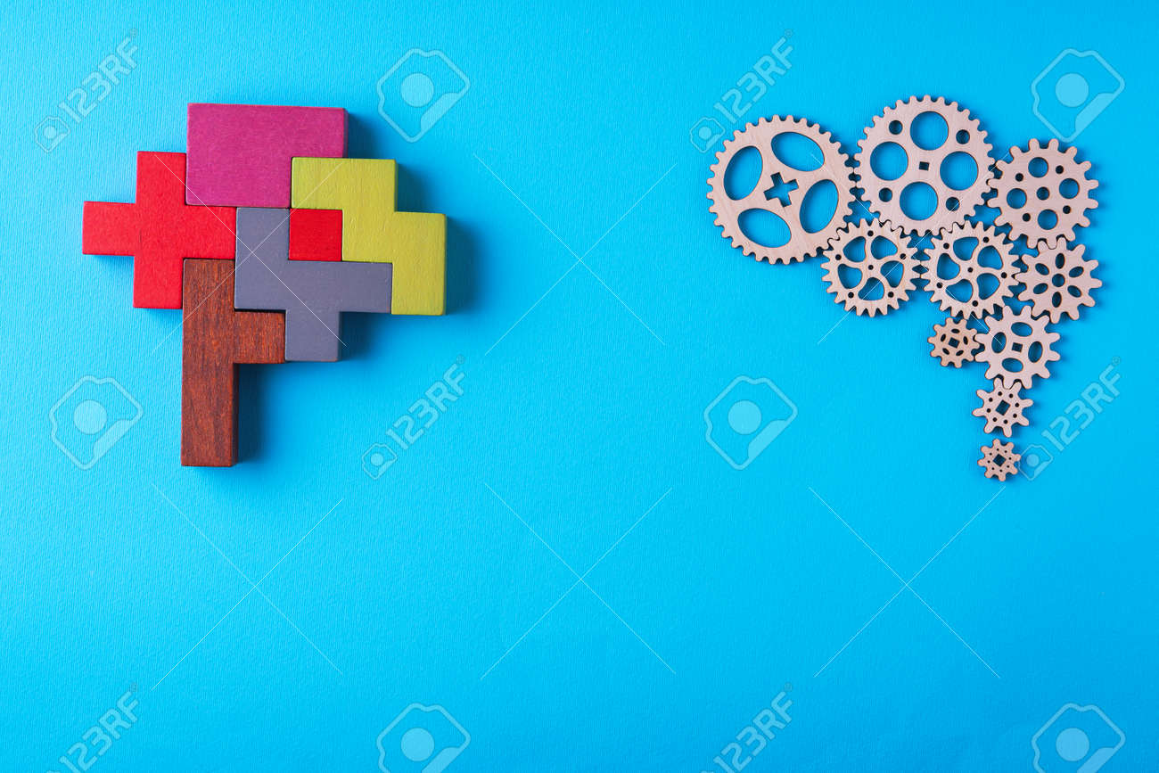 Human brain is made gear mechanism and colorful shapes on blue background. Two different thought processes. The concept of rational and irrational thinking. - 166110952