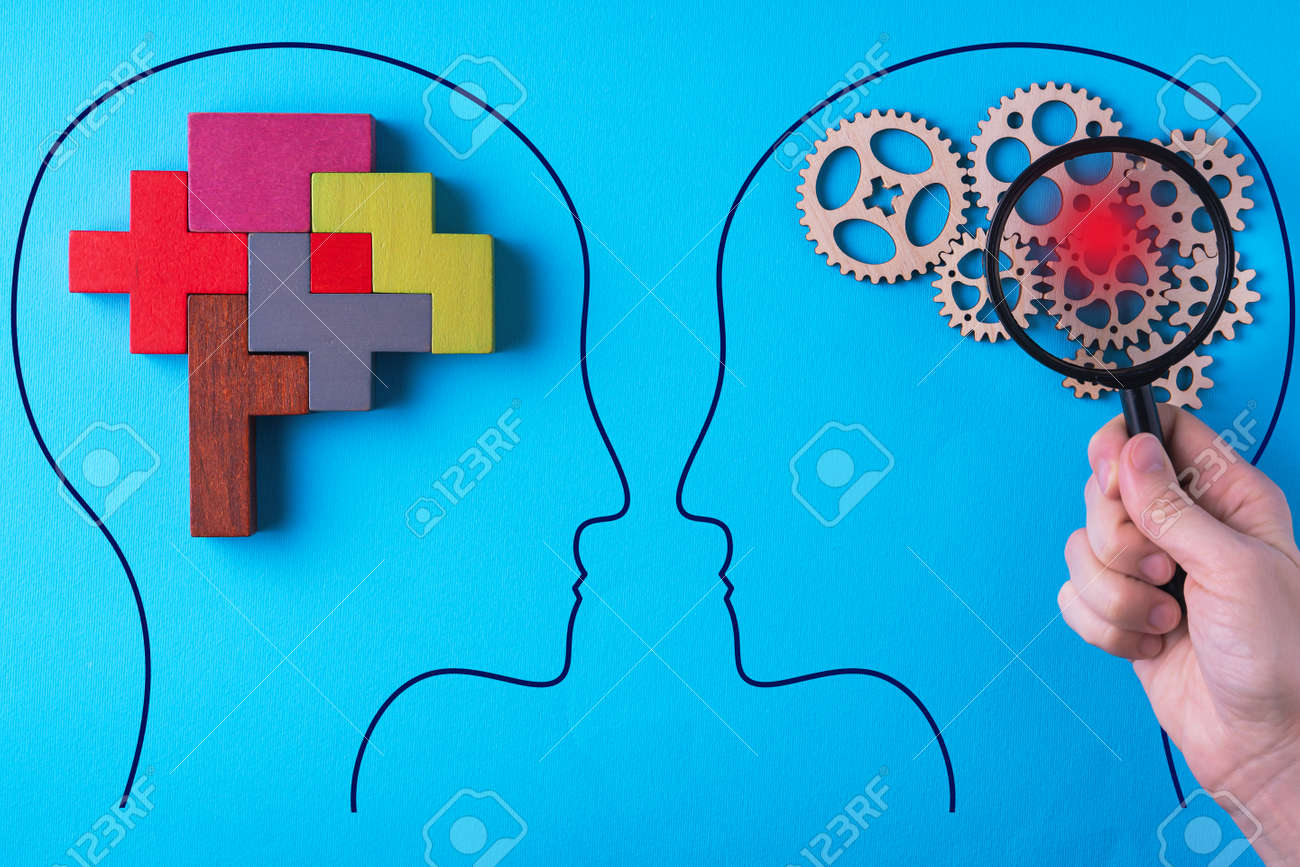 Human brain is made gear mechanism and colorful shapes on blue background. The brain is viewed through a magnifying glass. Brain disturbance concept, brain disorder. Different thinking. - 166283946